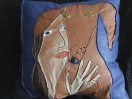 "Maarja Undusk – Leather pillow ""In the shadow of the dog"" (2005, leather, hand-stitched, 60 x 60 cm)"